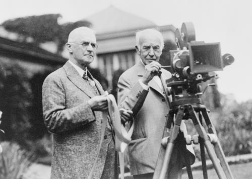 Thomas Edison and George Eastman standing with motion picture camera.